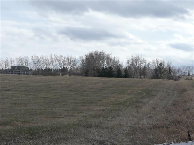 Great opportunity to purchase your dream building lot just 5 minutes south of Calgary on DeWinton Riding Club Road. A gentle sloping lot with views of Calgary's city lights and the rolling foothills. Paved roads lead right to the front of the lot with 3 golf courses within a 10 minute drive. There is no building commitment and services on site. This land also has subdivision potential, with approval from the MD of Foothills.