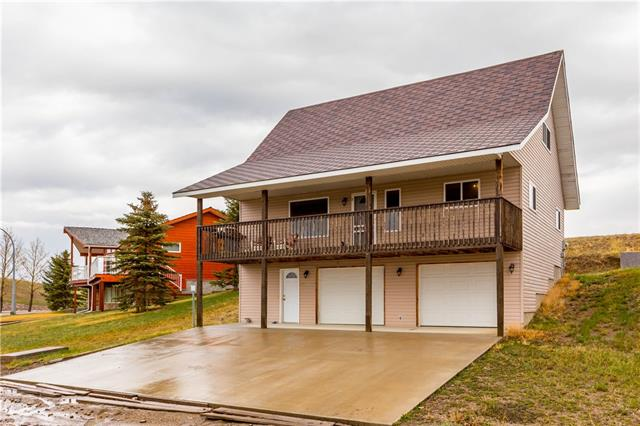 323 Wildrose Way Vulcan County  C4244383 - Click Brochure for more photos, floor plans and much more! Directions To Property - From Calgary Travel South On Highway #2.  Just South Of Parkland Turn Left (East) On To Hwy #529 You Will Cross Hwy 23 At Champion Continue East Bound On Hwy 529 For 37Km. Follow The Signs To Little Bow Resort Which Will Be 17 Km (You Will Pass The Entrance To Little Bow Provincial Park) Turn Right (South) On To Range Road #212 (Gravel Road) This Road Will Then Turn Right Going (West) On To Range Road #213 Make Your First Left Turn Then Take Your 2nd Left Turn Onto Wild Rose Way.