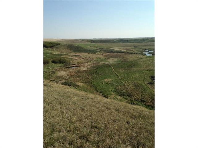 Beautiful spot to build your dream! Picturesque 13.64 acres with a coulee and a spring right off of Highway 21. Rolling hills and a valley would make a great place for a walk out. County water line past the property.
