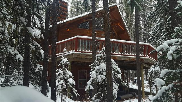 IMAGINE that in 1.5 hours you could transport yourself from the bustle of urban Calgary to fresh pine scented air and peaceful quiet. Located on the Lower Kananaskis Lake, Whispering Pines was originally a small A-frame, that underwent a stunning Linwood Homes addition in 1988. The result is a spacious cabin with spectacular views, nestled among the pines and just steps away from the Lake.  Fully furnished and complete with household goods, you can just unlock the door and begin enjoying this spectacular mountain retreat.  There are two bedrooms on the main floor as well as a great loft that can sleep 5.  The wood burning fireplace has circulating fans to keep you cozy on the coldest of winter nights, and the large deck is a spectacular place for your morning coffee.  Also included is a 14? fishing boat with motor to help you win the annual Fishing Derby, a canoe, paddle boat and barbque.  Make this your mountain home and enjoy all the opportunities Kananaskis has to offer right out your front door!