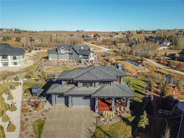 Welcome to this beautiful custom-built Trickle Creek home in the award winning community of Watermark. On almost � an acre, this home boasts mountain and waterfall views from 2 levels. Situated in a quiet cul-de-sac this Prairie style home offers over 4300 sq ft of luxurious living space. The custom kitchen comes complete with $30k Meile appliances, walk-thru pantry and oversized island. The main living area has beautiful hardwood floors, coffered ceilings & an abundance of floor to ceiling windows. An office with barn door, custom built-ins, a mudroom & powder room complete the main level. An open riser staircase leads to the second level with hardwood floors, 3 bedrooms, 4-piece bath, and spa like ensuite with in-floor heat, laundry room & bonus room. In the basement you?ll find a huge rec room, addtl f/p and gym/4th bedroom. Triple Pane windows throughout, custom built-ins, A/C, 10 ft ceilings, water filter & softener, Camera/Security, $25K soffits, heated garage, hot tub, invisible dog fence & more!