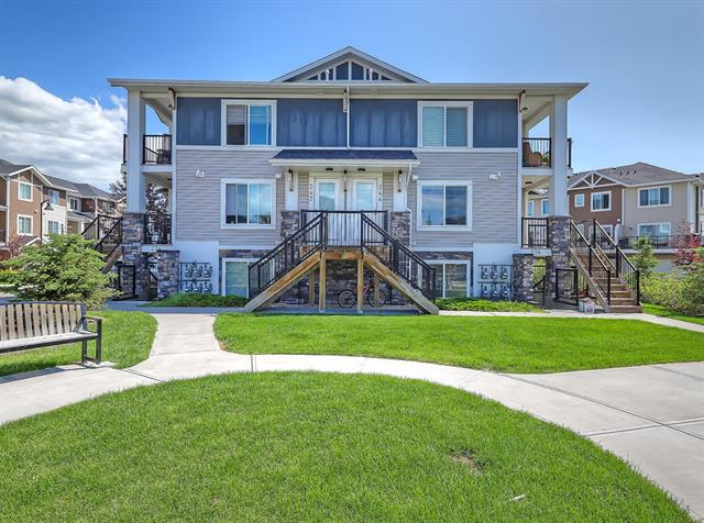 Welcome to Chestermere Station! Come out and have a look at this fantastic 2 bedroom condo located just steps away for all of the wonderful amenities the area has to offer including the lake, shopping, coffee, restaurants, pathways and parks, just to mention a few. This 3rd floor, open concept, corner unit is ready to move in (or alternatively to have as a fully managed investment property). Built in 2012 this condo shows very well with neutral paint colours, L shaped modern kitchen design, black appliance package, in suite laundry incl extra room for storage, low condo fees of under 165 dollars a month (each unit has their own furnace and hot water tank), and an assigned parking stall. This condo complex allows pets and you may have up to 2 cats or 2 dogs or 1 of each, birds in a cage and fish in a tank are just fine too. It doesn't get much better than this.  This unit has a great tenant in place if you are looking to keep a fantastic tenant.  Call your favourite Realtor and book your showing today!