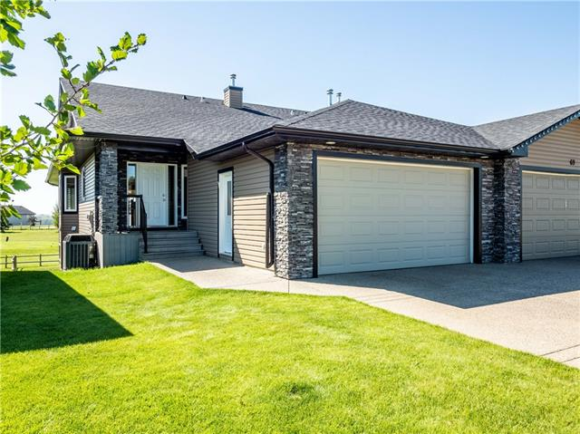 Life on the Links! Welcome home to the golf course community of Speargrass, nestled 30 kms SE of Calgary, on the banks of the Bow River. This renovated semi-detached bungalow backs onto the 10th tee box of the privately owned & professionally operated 18-hole championship-level golf course. Stay cool all summer long with central AC. Beautiful hardwood floors & natural night flow throughout the home's open, airy layout. Main floor highlights include a den for the perfect home office, chef's kitchen w/newer SS appliances, living room w/gas fireplace & built in shelving, master bed w/ensuite that includes a soaker tub & separate shower & additional 3-piece bath. The bright & spacious lower level w/full walkout, has a large family room, media room, 2nd bedroom, laundry & 3-piece bath. Enjoy the view of the golf course on the balcony w/your morning coffee & spend the evenings BBQing on the deck. With world-class trout fishing & extensive green space just steps away, Speargrass has something for everyone.