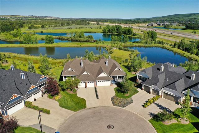 "LOCATION ALERT - This exquisite 3 bedroom villa backing Clearwater Lake is truly phenomenal! Pride of ownership is visibly apparent in this stunning property with 3079sqft of developed space. The main floor hosts hardwood flooring, flat finish ceilings, open concept vaulted great room w/focal gas fireplace and exceptional custom built-ins, a gorgeous white kitchen w/stainless steel appliances, granite countertops, a ""hidden"" walk-in pantry and a contrasting eating island, dining space with outdoor patio access and views of Clearwater Lake, serene master retreat with oversized bedroom, walk-in closet and ensuite w/dual sinks, soaker tub and generous shower, spacious den and laundry/mud room combination. The walk-out level features in-floor heat, flat finish ceilings and hosts an exceptional family room with gas fireplace and custom built-ins, wet bar, 2 additional oversized bedrooms, hobby room and full bath. The outdoor spaces are perfect for enjoying the peaceful lake views or relaxing with a good book."