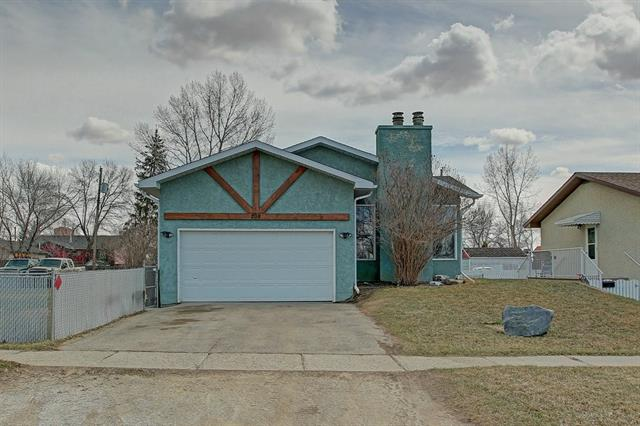 Live in a wonderful small town with convenience to commute to High River, Okotoks or Calgary. This large bungalow features over 2600 sq ft of living space, huge country kitchen with island, dining room, patio doors to a large SW facing deck, main floor laundry, cozy living room with fireplace and wall mounted TV, master bedroom with spacious walk in closet, 4 bedrooms total, 2 bathrooms, large windows in the lower level, Massive recreation room with pool table plus a family room with fireplace, walk up into the front double attached garage and 2 new furnaces on order. This home is very clean, it has been well loved and maintained with many upgrades. THIS PRICE ALSO INCLUDES ANOTHER TITLED LOT NEXT DOOR. Endless opportunities, Excellent price!!!! Don't miss it!!!