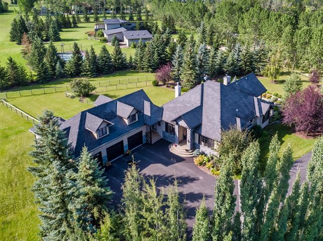 OPEN HOUSE SAT NOV 2ND 1:30-3:30PM!!This magnificent 'French Country Cottage' styled estate home is located on a private acreage on one of the most beautiful quiet streets in the Red Deer Lake area. Located within 15 minutes to every imaginable amenity, including world class equestrian facilities, fine dining, shopping and top tier schools, this home is ideally situated to offer its residents the quiet of country living without sacrificing the amenities of the city. MAGNIFICENT GARDENS and MATURE TREES surround the home and provide maximum privacy. In the winter, when the leaves are off the trees, you can sit on your back deck and take in the beautiful MOUNTAIN VIEW. Offering three bedrooms, an upper ?bonus? room, 11? ceilings, a DESIGNER KITCHEN, a triple attached garage with FRONT AND REAR ACCESS and a spacious WALKOUT with a home gym, a games room and a media room, this incredible home has something for everyone. Meticulously cared for by the original owners, this is truly a one-of-a-kind hidden gem.
