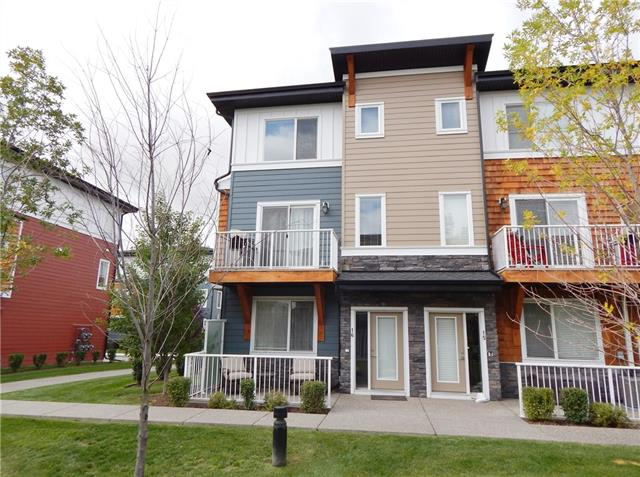 Beautiful 3-storey END UNIT townhome in the Reflections complex of Rainbow Falls! Great location on a quiet street. Luxury VINYL PLANK floor & 9? ceiling on the main floor w/ knockdown texture throughout. A bright den on the main floor with a spacious entryway. Step up to the main living area w/ a generous great room. Fabulous kitchen offers full height cabinetry w/ matching STAINLESS appliances, a LARGE central island, peninsula w/ extended stool bar, & pantry. Plenty of counter space with QUARTZ counters in the kitchen and full baths. Bright dining area. Upstairs, a spacious master bedroom has a 4-pce ensuite w/ SOAKER tub/shower combo. Two good sized kids? rooms plus a 4-pce bath & convenient UPPER laundry. Double attached garage, insulated & boarded. Sunny deck just off the great room plus a ground floor patio facing the common greenspace. Plenty of visitor parking.