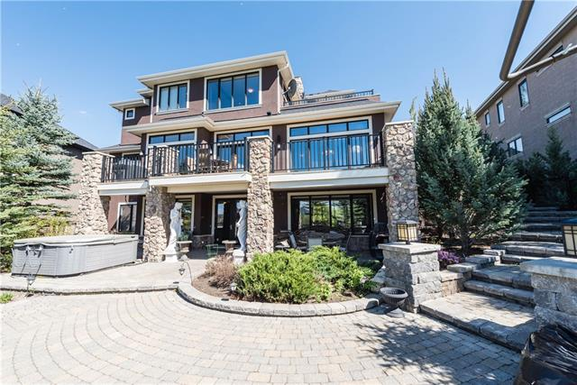 WELCOME TO THE INCREDIBLE AWARD WINNING ALBI MONTICINO DESIGN!! This stunning 2-Story Walk-Out has over 5300 sq ft of developed living space located in the heart of Heritage Point, moments from the lake w/ an amazing Backyard the size of a Football Field, designed beautifully w/ Stone walkways overlooking the ravine.