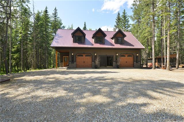 MUST BE SEEN TO BE APPRECIATED.  Super 5+Acre nicely treed lot just south of Water Valley. A great location for peace and quiet in the country. This fenced lot is 5 minutes from the Golf Course. The unique 2 storey home has living area over a finished double garage which currently serves a family room area & a single garage/workshop. The upper floor features a spacious Bedroom with en suite, kitchen outfitted with Stainless appliances & quartz countertops. The living room is enhanced with a rock faced gas fireplace, dining room and hardwood flooring featured throughout this floor. Various outbuildings on this lot including sheds & a covered entertainment area.  Recreation abounds on the quading trails on the property and the general area features golfing, hiking and fishing in nearby Winchell Lake.  You could build your dream home here if you want more!