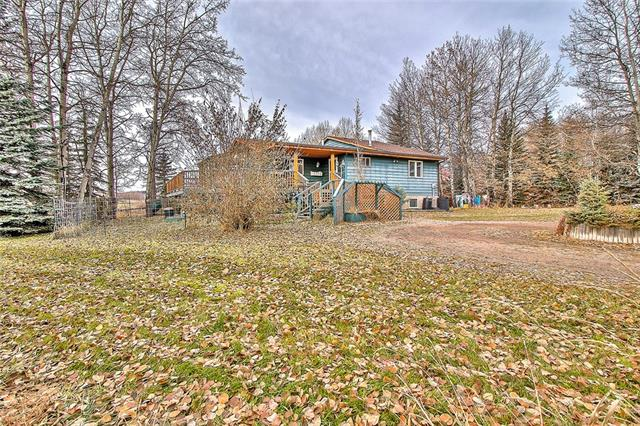 Are you looking for a quiet life on an acreage in peaceful Millarville? This is absolutely a MUST SEE! Here are at least 8 REASONS WHY YOU SHOULD BUY IT: 1) Affordability - by far one of the most affordable properties within a 30 min drive to Calgary. You just won't find more of these! 2) The Nature - you are in the beautiful Foothills, away from hustle and bustle of the city. Watch the amazing sunsets, breath the clean air and enjoy the wildlife around you! 3) The amenities - send the kids across the street to Millarville Community School(K-8), visit the famous farmer's market in the summer, take a short drive to Turner Valley, Black Diamond or Bragg Creek. 4) The house - a large open concept 5 BEDROOM BUNGALOW is perfect for a big family! A lot of natural light through the south facing windows!!! 5) Fully Developed basement. 6) THE GARAGE/SHOP - for all of your cars and hobbies! 7) The huge WRAP AROUND DECK is ideal for the family/friends gatherings. You need come and see this in person. Hurry!