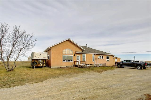 Wonderful chance to own an acreage just minutes from the beautiful town of Claresholm!! Drive up and be impressed by the rail fencing and a sprawling bungalow and beautiful hip roof barn!! This property is fenced and crossed fenced perfect for your 4 legged friends.  Walk into this bungalow and enjoy a large entrance, walk up and into your huge country kitchen with tons of cupboards and a huge island perfect for meal prep!! New windows through out will save you money through out the year!!  A decent sized main floor laundry room makes laundry a breeze.  2 good sized bedrooms located away from the master with a 4 piece bath.  A large master with a  3 piece ensuite and a walk in closet is always a bonus.  A massive living room with amazing views and a bonus loft that could be used for a play room or an office!!  A single car garage is perfect for not having to remove that pesky snow in the winter and the barn is perfect for keeping the horses warm in the winter storms!  This property checks all the boxes!!!