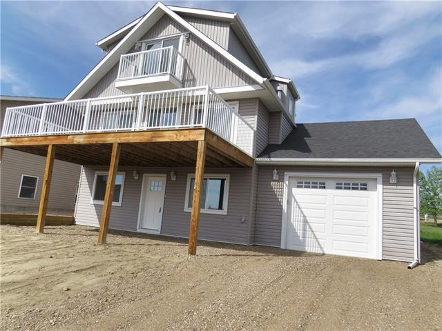 Here is a chance to buy a Newly completed never lived in 2 story year-round lake home with walkout basement. This custom designed & built home has over 2,200 sq/ft of living space with five bedrooms. On the main level the large open concept Kitchen features, solid plywood and mdf cabinets, quartz countertops and a full stainless appliance package. Your kitchen looks out to the open living and dining area with access to your huge front deck with lake views. The ground level features a large family room (a great place for the kids to relax), two additional bedrooms and 4pcs bath. The top level has two large bedrooms one with a deck giving you 180 deg. lake views plus a 4 pcs bath. All baths come with the same quartz countertops. There is solid flooring throughout. The large attached garage can store your car or all those summer toys. The home is located on a large lot backing onto green space and is a short walk to the beach. This home is covered by ?New Home Warranty?. Call today to view!