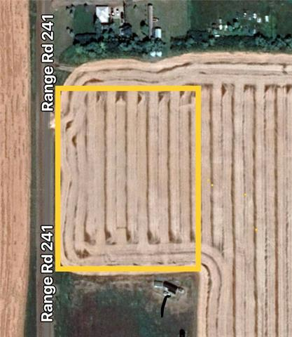"5.49 acres of recently subdivided bare land ready for your dream home development just minutes north-west of town. This parcel is located on the west side of the actual ""three hills"" for which the town was named.  Amazing open country views to the south-west from this high & dry location.  New approach constructed into the land.  Location serviced with municipal water hook-up."