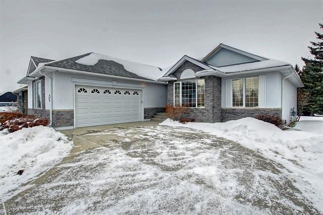 Located 5 min. south of the New Hospital this is your chance to own a gorgeous bungalow in one of the nicest Golf Course Communities near Calgary.  This home has what every bungalow should have: lots of main floor space.  The high ceilings in the living room really give this home a large feel that boasts a fireplace in the center of the room with build in cabinetry on both sides.   There is a large eating area next to the living room that leads onto a deck overlooking the golf course.   The kitchen has lots of cupboard space with a pantry and a 2nd eating area for the quick breakfast.   Its a real bonus having 2 large bedrooms on the main floor + Den with two full bathrooms.  The master bedroom overlooks the golf course and it has a very large ensuite bath with soaker tub and separate shower.   The lower level is fully finished with a very large family room that will accommodate furniture and pool table   Its very convenient to have a 3rd guest bedroom and bath too.  This home is priced to sell.