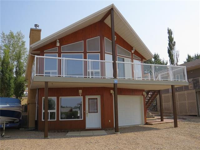 Here is a fantastic opportunity to own in a lake community 1.5-hour drive from Calgary. Little Bow Resort is located at Traver?s Reservoir. A deep, beautiful, & clean lake. This year round custom designed/built home has spectacular lake views. Imagine having your morning coffee looking at a sparkling lake. This home has over 2000 sq. ft of living space with 4 bedrooms and 2 baths. The spacious family room has vaulted cedar ceilings with stone faced wood burning fireplace, custom county kitchen & dining room. This property is beautifully landscaped with low maintenance paving stones and planter boxes. The home features central heating, air conditioning and three zones of in-floor heating in the basement. In the summer enjoy, boating (Little Bow resort has its own private marina); swimming with a sandy beach & unlike other destination Traver's is not overcrowded. Traver?s is also great as a year-round recreation destination with ice fishing & skating in the winter. Don't miss this one - call today to view!