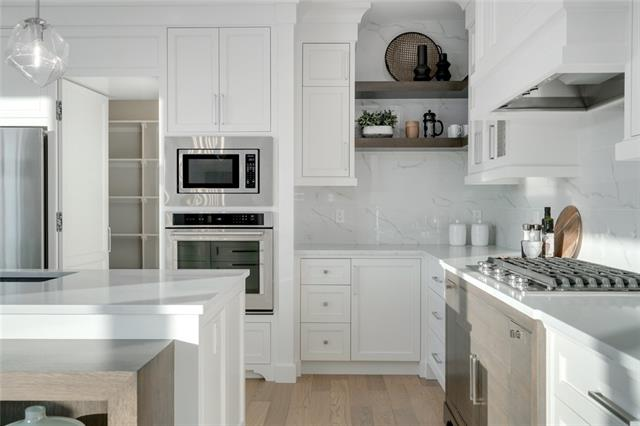 Move into this stunning home now! Wolf Custom Homes is well known for luxury finishes & attention to detail, & this home is no different. This stunning Modern Prairie open concept home at more than 4,000 sq ft boasts luxurious features & thoughtful details, such as a site-finished, chef inspired custom kitchen, 9? ceilings on every level, 8? doors on the main floor, oversized windows to maximize light, granite countertops throughout the home, a fantastic laundry room with upper & lower cabinetry & generous sink, a spa inspired master ensuite with freestanding tub, mudroom locker detail, site-finished closets throughout the home & a fully developed basement. Sunny days on the large, bright southwest deck, & gorgeous views of the pond across the street, will be enjoyed by the entire family. A two-minute walk from the Central Plaza, this home is perfectly situated to allow you to enjoy the community year-round.
