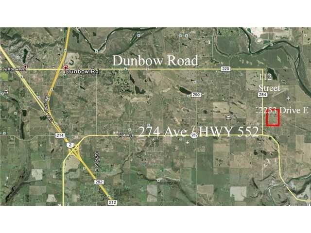 Wonderful 4.5 Acres of land with MOUNTAIN VIEW less than 20 minutes to Calgary. Drilled water well is at 8 GPM. Easy access on mostly paved roads.
