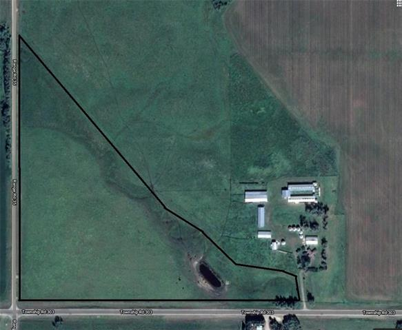 A MUST SEE this one of a kind 22.59 Acre acreage. This acreage is along the pavement with the entrance at the corner of the pavement and the gravel road. With a mountain view and a seasonal creek running from the NW to the SE which feeds into the dugout that is on the property, this is a great location to build your dream home on an acreage big enough to have animals and for the usage of your toys. Natural gas line runs through the property and the power line is along the road. This acreage is only 5 minutes to Cremona and 15 minutes to Carstairs and Hwy 2. Please call before walking on the land. Selling realtor has an interest in the property. GST may be applicable.