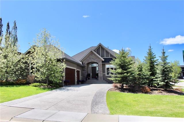 """This Former Showhome is a Spacious 2049 sq/ft Bungalow with with Triple Garage. In floor heat in basement and garage Enjoy the beautiful Sunrise & Sunsets from the 1/3 Acre West facing backyard located on a quite cul-de-sac. 10' Ceilings, High-End Stainless Steel Appliances, cabinets to ceiling, Home Theater/Fitness Room, Spacious Custom Kitchen, Expansive Deck, Custom Tile Showers and Extensive Wood Working just to name a few of the standard features. Also, all public sidewalks and street snow removal is taken care of in this fabulous community! Notable Extras: Creston Sound System, Speakers thru-out, In-floor heat in basement and garage, heated ensuite & Mudroom floors, 10 ft ceilings up and 9' down,8' Interior doors*, 10"""" Baseboards,  leathered granite counter tops, Top of the line Jennair Gas Cook-top, Wall Oven and Microwave, central air conditioning, drive-thru front drive, 42""""x 96"""" front Masonite door. . . and Much Much More!"""