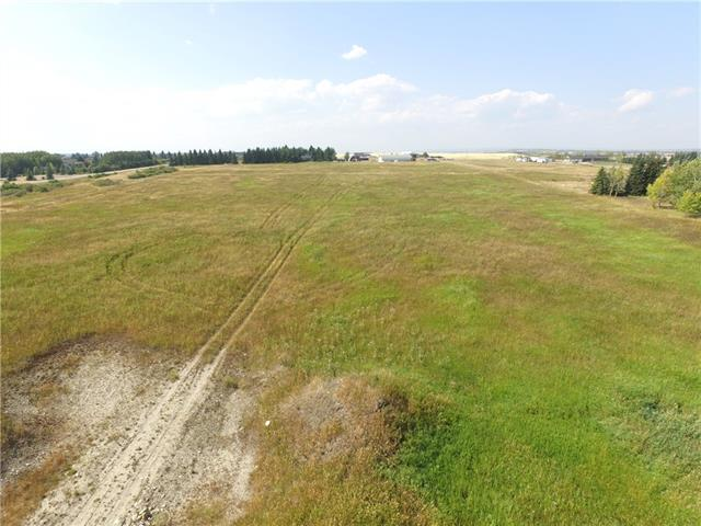 This property is on the Bearspaw Saturday Tour of Homes May 2, 2020 from 1:00 to 1:20pm. Great 4.67 acre Mountain View property in the Greater Bearspaw area. The R2 (minimum 4 aces) lot is gently sloping with some undulations. Easy to build on and only the county rules for development apply. No additional restrictive covenants. The lot is serviced by the Rocky View Water Coop and the other services are in the ditches adjacent to the property. The lot is oriented north/south, for a south facing front yard. It is easily fenced for a horse or some other beasts.