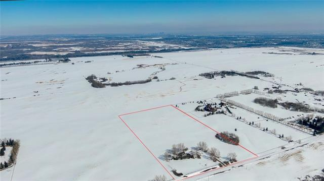 "Located in the Providence ASP 1 & within Calgary City Limits, this 20 acre parcel is zoned S-FUD. At this time, it is forecast to be just south of future LRT station. Property is north of spruce meadows and highway 22X, with easy access to the RING ROAD. Land is currently flat farm land with MOUNTAIN VIEWS and NO ENVIRONMENTAL RESERVE (all developable). This is one of the last few parcels not owned by developers. Buy & Hold while Calgary expands towards this enviable property. House sold ""as is, where is""."