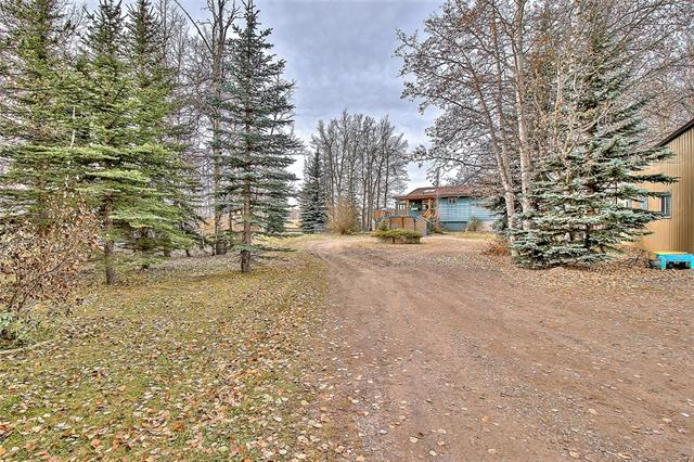 Calling everyone who has been dreaming to get out of the city and live on their own acreage!!! This is IDEAL for families wanting to raise their kids in a quiet peaceful place, a retired couple or anyone looking to get away from the hustle and bustle of the city...Millarville is perfect for it. You are right across the street from the unique school(K-8) with a rare IB(International Baccalaureate) program. This by itself is worth moving here! The hamlet is located only 20 min away from the south end of the city. You are just 6 songs away from the Somerset LRT, shopping plaza, hospitals, etc...think about this! Are you a car guy, a business owner or simply have a lot of stuff to store? YOU WILL DEFINITELY APPRECIATE a huge 30'x40' SHOP which is perfect for all of your hobbies and activities! The HOUSE is a very solid 1462(on the main floor) bungalow with a fully finished 1342 sq.ft basement. IT'S A VERY SPACIOUS 5 bedroom(3 up/2 down) HOME! This is absolutely worth seeing! Call now and book your showing