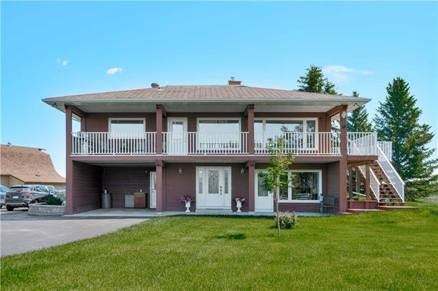 17.8 ACRE HORSE FARM LOCATED TWO MILES NORTH OF HIGH RIVER. THIS WELL MAINTAINED 1,785 SF RAISED BUNGALOW HAS A FULLY DEVELOPED WALKOUT LEVEL, A 5 STALL 28X48 BARN WITH LOFT, TACK ROOM AND GAS RADIANT HEATER, A 24X36 HEATED GARAGE, A 12X32 HAY SHED, AN 8X8 GARDEN SHED AND TWO HORSE SHELTERS. THERE IS AN OUDOOR SAND ARENA 100 X 180. GREAT MOUNTAIN VIEWS FROM THE HOUSE. THE HOUSE HAS AN UPDATED KITCHEN WITH GRANITE TOPS AND LOADS OF CABINETS AND A GAS STOVE. THE EATING AREA IS LARGE AND BRIGHT, THE LIVING ROOM HAS A WOOD FIREPLACE, LAMINATE FLOORS AND TONS OF SPACE. THERE ARE 3 BEDROOMS ON THE MAIN LEVEL AND ONE DOWN IN THE WALKOUT. THERE ARE MAIN BATHS UP AND DOWN AND AN ENSUITE WITH THE MASTER. THE WALKOUT HAS A LARGE BRIGHT OFFICE, A HUGE FAMILY ROOM AND A LARGE LAUNDRY / MUD ROOM. WINDOWS AND DOORS HAVE BEEN UPDATED. THE HOME IS IN MOVE IN READY CONDITION. A NEW SEPTIC TANK WAS INSTALLED IN 2016. LOCATED AT THE END OF A CUL DE SAC WITH NO TRAFFIC, PRIVATE AND QUIET. GST will be payable on a portion.