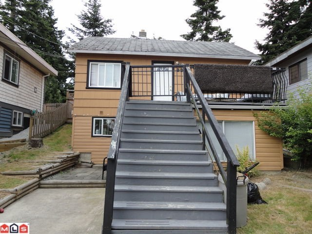 Investors alert. Great building lot or great tenant. Two bedrooms up & an in-law suite down. Upgrades with hardwood floors, maple cabinets, granite... 1/2 block to beach. New home could have a view.