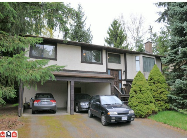 Well cared for by original owner. Gracious size rooms with 1350sf main floor and 911sf basement with rough in for full bathroom. 3 bedrooms up, 1 down, 2 full bathrooms Master with full en suite and walk-in closet. Roof, furnace and hot w ater tanks all replaced since 2009. Large lot near 8200 sf. west facing and private. Carport almost a garage easily enclosed. Excellent location quite close to the amenities.