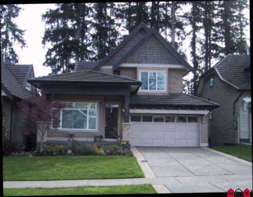 ST.ANDREWS by POLYGON in the Rosemary Hts area. 3 bedrooms plus a den with the m aster bedroom on the main floor. This home includes hardwood floors in kitchen,  eating area and family room. Kitchen includes an island and quality cabinetry. Decorated in modern colors, this home features a private rear yard backing onto parkland. Approx 1300 SF basement with a separate entry is unfinished and awaits your ideas. Close to shopping, Morgan Creek Golf Course and easy access to Hwy 99. Grea t family home with front porch and large back sundeck to entertain, double garage and two gas fireplaces.