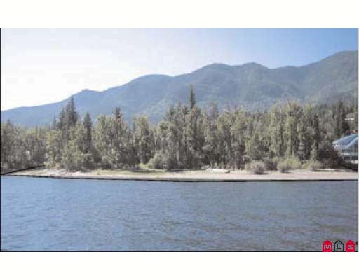 4 ACRES WATERFRONT on pristine SHUSWAP LAKE, 5 miles West of Sorrento! Rare, level lakeshore paradise with 544 feet of beach! Former family estate for 70+ years! In the heart of British Columbia's recreational 4-Season playground! A once in a lifetime opportunity! Build your executive retreat in this unsurpassed, pristine natural setting! 11-lot subdiv. potential. Older 2330SF, 3BR, 2 bath Heritage 2-storey home. One of the most beautiful settings on Shuswap Lake! Enjoy fabulous fishing, boating, 4 championship golf courses & stunning scenic setting! 1 hour E. of Kamloops, near Kelowna + 21 miles NW of Salmon Arm. In winter ski at World Class Sun Peaks, Big White,Silver Star & Revelstoke! One in a Million! Now is the time to buy!