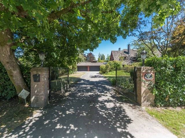 Rare 1.8 acre(7304m^2) of beautifully landscaped estate in the best kept secret, upscale Southlands. The property faces Point Grey Golf & Country Club and it's within 20 min drive to shopping, golf courses, airport, downtown, beaches, prestigious private/public schools and UBC. The impressive 191ft x 297ft regular lot has potential to build up to 9000sf mansion in the future. Meanwhile, enjoy the charming 2 level Tudor home boasting 4327 sf of elegant living. As a bonus touch there is a barn on adjacent 157ft x 138ft land, with separate side street access, to accommodate 4 horses.