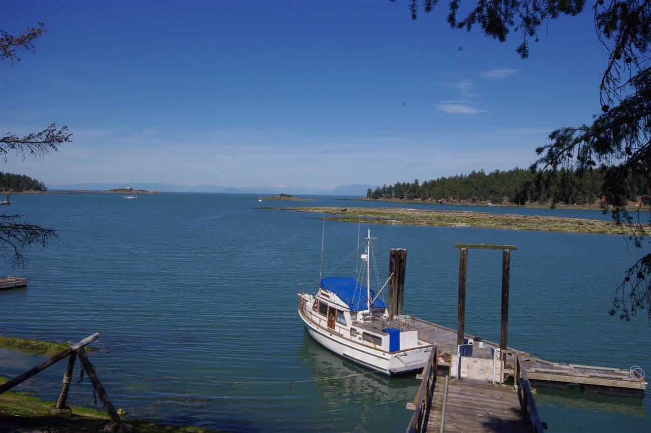 ATTENTION BOATERS! Desirable Whaler Bay home on over 1.5 acres of land with registered DEEP WATER DOCK for large boats. The well designed 40x12 main float & 12' finger are built by the present owner with a secured base which can accommodate a boat more than 6' draft. Power hook up on float. The outbuildings include 14x46' garage - workshop which is well built and insulated, set up for woodwork with 60-amp. The solidly built house overlooks dock and 163 feet of waterfront. Master bedroom on 2nd floor with deck & ensuites. Open kitchen good for entertainment, large deck overlooking the water. View from every room, all measurements are approx.