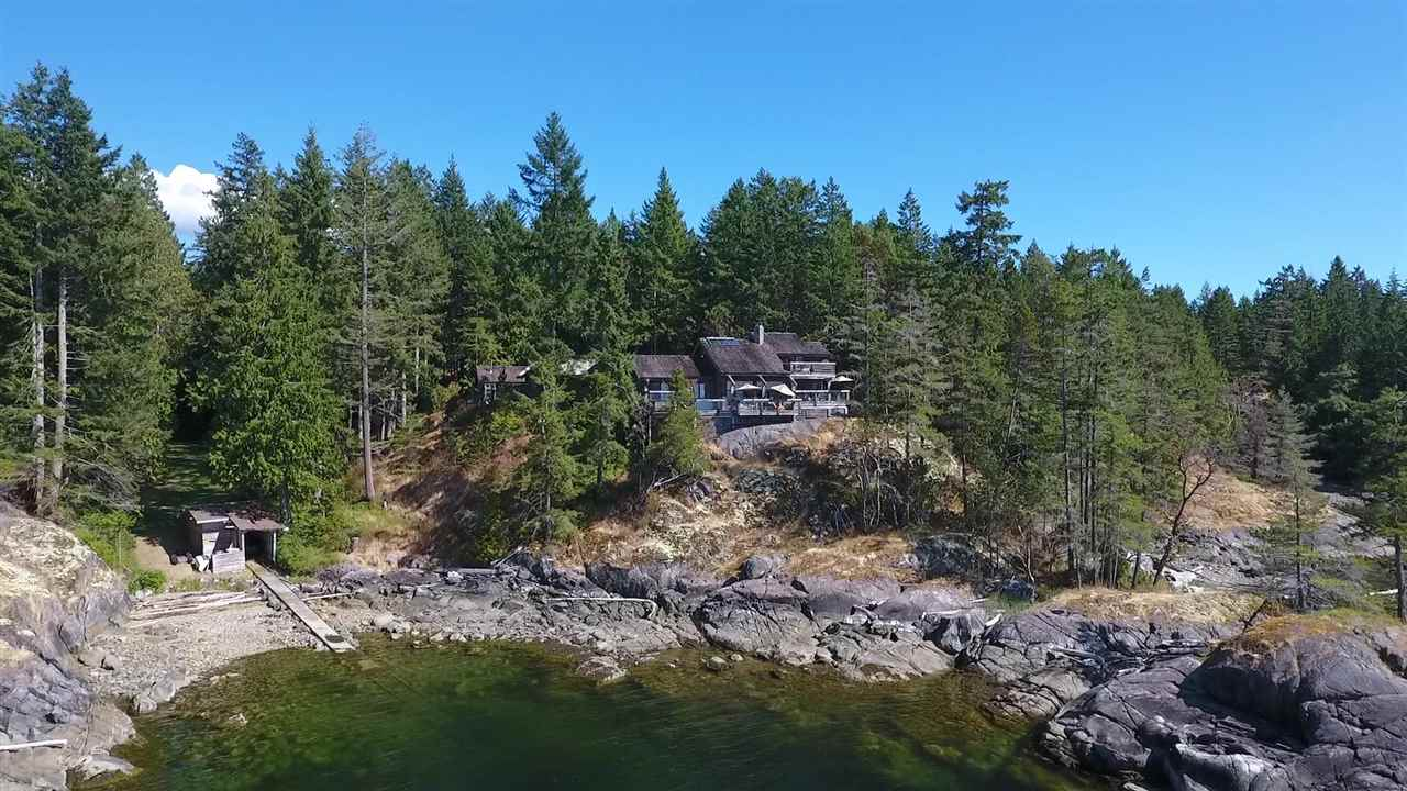 20 acres of privacy awaits you at this one of a kind property! 667 feet of waterfront including your own cove w/boathouse. Watch the sea otters, eagles and, yes, the occasional dolphin or whale from the large waterfront deck. The custom built post and beam home has a view of the water from almost every room with 4 bedrooms, 4 bathrooms in 3,332 sq ft of comfortable open living space. Do you hear that? No! You'll only be hearing the sounds of nature in this totally serene setting. Pond, gardens and rustic guest cabin complete this package! Call today for a private showing.