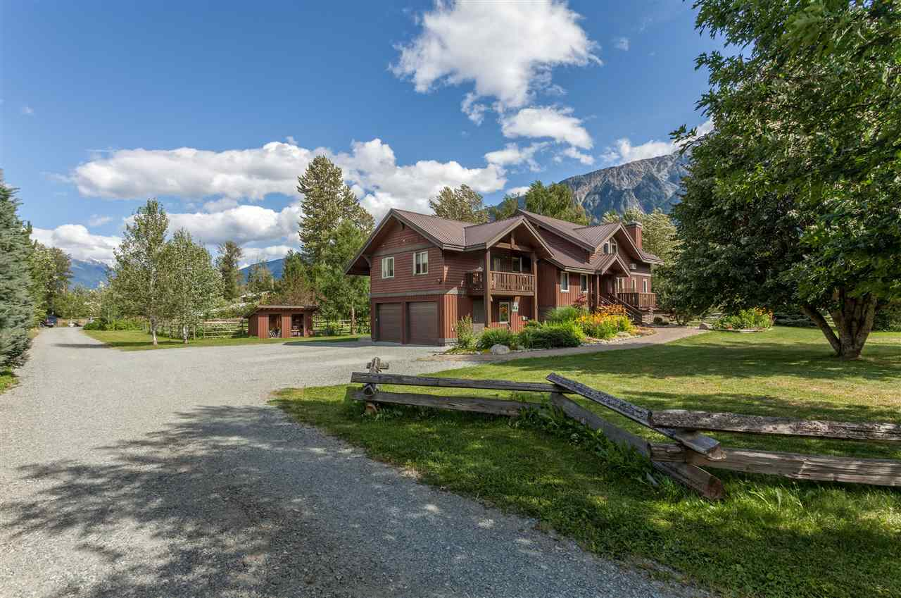 This beautiful custom post and beam home (3130 sq. ft.) located close to town with spectacular views of Mt. Currie and surrounding mountains sits on 10 acres of fenced pasture, multiple paddocks, with horse trails, fruit trees, flower & vegetable gardens. A horse-lover's paradise! Includes top quality 5-stall 1350 sq.ft barn w/ trainer/guest suite! The open floor plan features 4 bedrooms, 4.5 bathrooms, a large loft, fireplace, vaulted ceilings, office area, walk in entry closet, 2 car garage, and a large semi wrap-around deck. 1 bedroom revenue suite w/ separate entrance above the garage. The house has 1500 sq.ft. full height storage space. Sunken-above ground pool, chicken coop, storage shed, and round pen were recently added.  It could be yours!