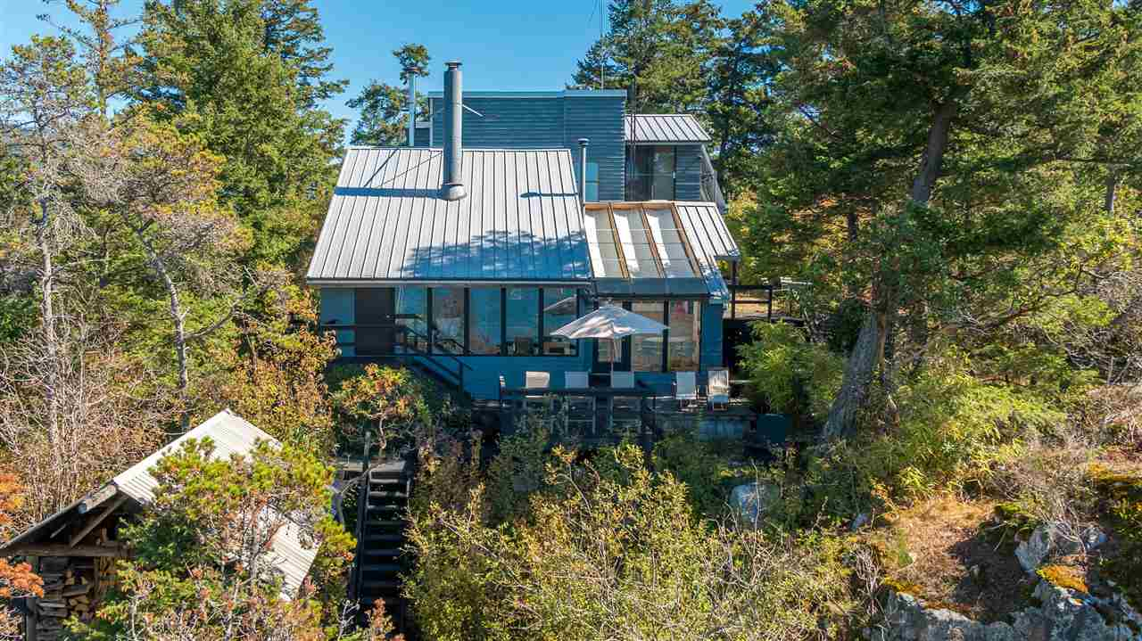 Beautiful SW ocean views from this architecturally designed custom built waterfront home. This is your dream getaway home, or live here year round! Just move in as this one has everything you need. 10 min from West Van Yacht Club by private boat. This eco-friendly, off grid waterfront home has an updated septic, 5 year metal roof, skylights, solar panels, generator, rain water catchment system, waterfront crane, cable lift/gondola, 3m skiff w/ 15 hp merc & an ATV Inc! Suspended L/V F/P, 1/3 acre and the list goes on. Privacy, tranquility, serenity, peace all found on Passage Island.
