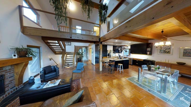 Stylish lakefront home with West Coast contemporary design ethic. Features dramatic living with vaulted ceilings. Features fireplace, entertaining style kitchen, spacious dining. Inviting & private master suite on upper level. Lower level with bedroom and family room. New septic and roof! Expansive decking. Attached garage / workshop. Lots of storage. Property offers forested beauty, meadow, orchard, private vineyard. Close to town. A very desirable family home.
