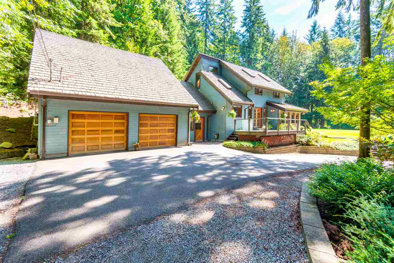 Zoning allows for SECONDARY HOME & possibility to SUB DIVIDE into 2 separate 1 Acre parcels. This nearly 3 Acre property sits quietly among the lush private forest. Awaken every day to your oasis in the trees. Plenty of room for that large family with nearly 3,000 sf ft, 4 bdrms & 3 baths. The master bdrm is found on its own floor with modern bath & den. Massive 850 sqft garage-Room for all the toys, while Games room above is the perfect place to send the kids - or already with its own entrance & bathroom -would make an excellent In-Law Accom. Post & beam construction with other unique building features can be seen throughout. This home was built with love & it shows. Plenty of room to run, jump & play in massive grass yard. Excellent timber value as well! Call today for your own private tour!