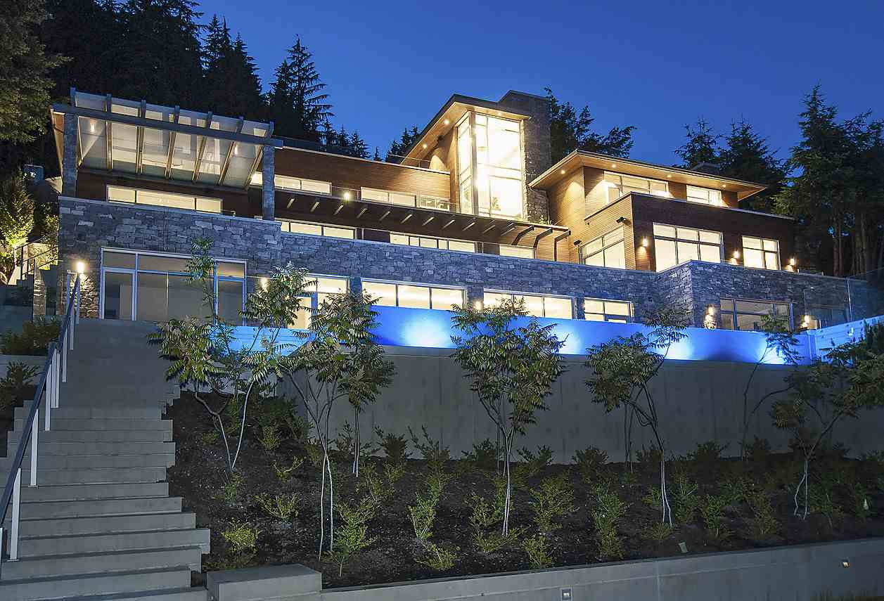 A Magnificent custom built luxury home situated on a large private estate property in West Vancouver?s most exclusive British Properties. Offering spectacular south facing city and ocean views, this 4 level 8800 SF, 6 Bedroom, 8 Bathroom home features extensive concrete construction with the highest level of quality throughout. Many additional features include: Private Elevator, In floor Heating, Air Con, resort style swimming pool, outdoor BBQ, 5 large walk out terraces with Waterfall, night lighting.