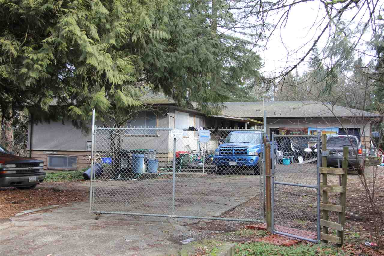 FANTASTIC INVESTMENT OPPORTUNITY: 7.41 Acres designated as Light Business Park in the approved Anniedale Tynehead NCP. No creeks or water coarse & easy access to 176 st. Golden Ears Bridge and highway 1. Double detached garage, 23' x 50' Workshop, 3 entrances to this large corner property at a dead end street. Ideal for trucks, RV parking or for storage yard. Tenant occupied - 24 hr notice required.