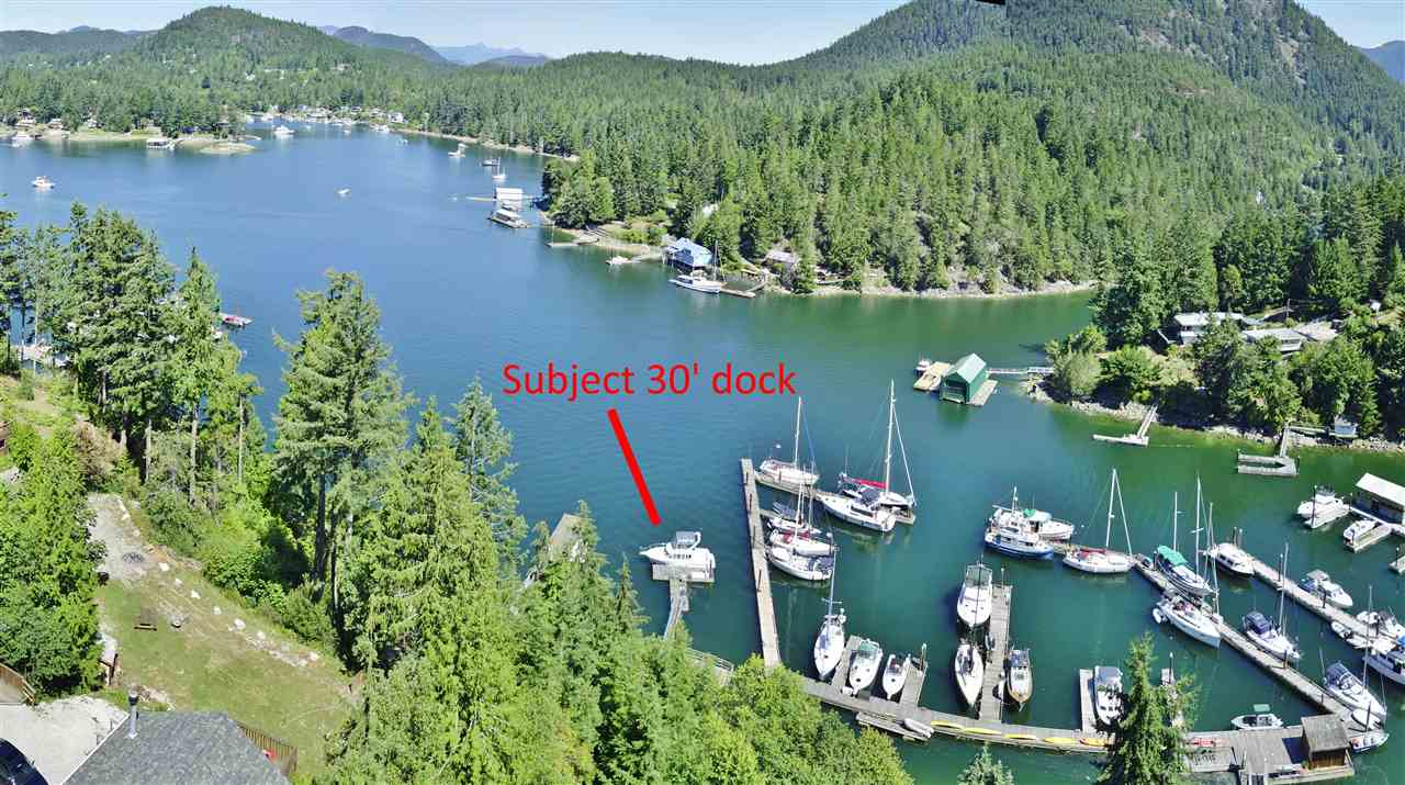 Year Round Deep Moorage at Private, 30' +/- Dock. ATV road from House to Pier & Dock. Private, Treed Acreage property is approximately 1.33 acres with multiple decks & patios to enjoy the Sunshine all day. The garden courtyards offer a mix of berries, fruit trees, flowers & shrubs, plus a fish pond with fountain. Sunken Great Room is detailed in Cedar with exposed rafters, features a cozy wood burning fireplace, & offers excellent space for a  gaming room, plus has deck access and an incredible ocean view. Tastefully updated Main floor Bath, Laundry & Kitchen, with newer appliances included. Pride of ownership is evident throughout this home. Plumbing RI in basement, for easy suite conversion.
