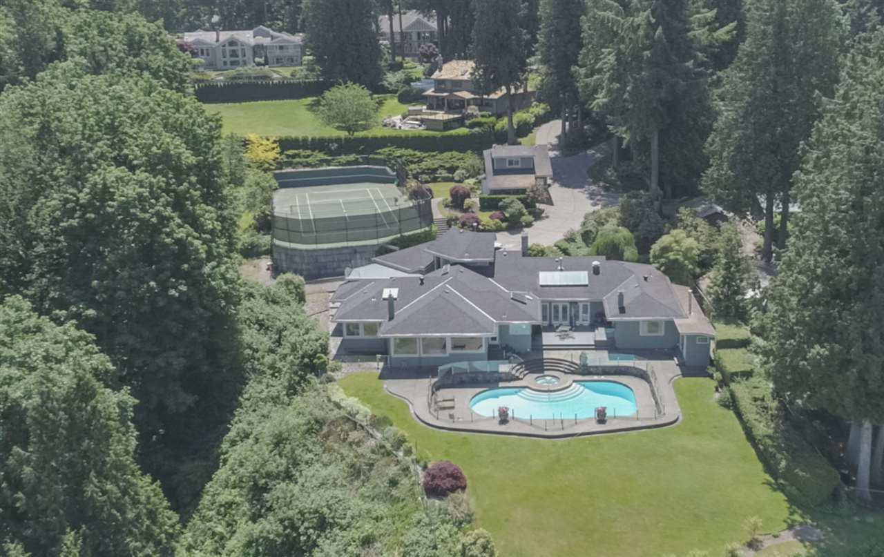 Elegant gated waterfront estate on 1.8 acres perched high above Crescent Beach with world class views of ocean and North Shore Mountains. Property boasts 230 ft of waterfront and tournament tennis court. Drive through private gate past coach house with 3 car garage, 1,150 sq ft, and guest house, 619 sq ft, to the stately sprawling rancher, 6,000 sq ft, meticulously maintained and updated with 6 bedrms, 5 baths, part basement, 2nd story office, Gunite pool with expansive multi level patios. Magnificent sunsets, meticulously maintained grounds, stunning architectural details, vaulted ceilings, custom lighting, hardwood/stone flooring, gourmet chefs kitchen, abundance of windows, isolated masters quarters.