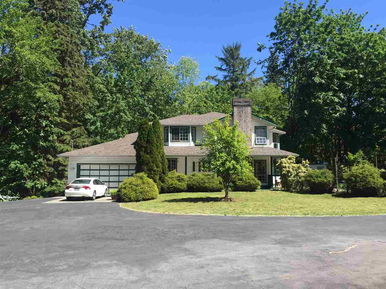 3,600 SF house on Gorgeous Park-like setting Private 4.74 acres of land, surrounded by mature trees & Big Salmon spawning creek runs through the property. Great future potential, located within Jericho & Latimer Land Use Plan. Front section designated as Jericho - Townhouses & back portion of Land designated as Latimer - Single Family Residential 3 (6-8upa). Property offers 2 storey/w BSMT home, built in 1990, insulated detached workshop, pool, picture windows and total privacy. City water & sewer on 80 Ave. Walk through outside only on first showing. The house is as-is-where-is condition. Truly Private Oasis in central location!