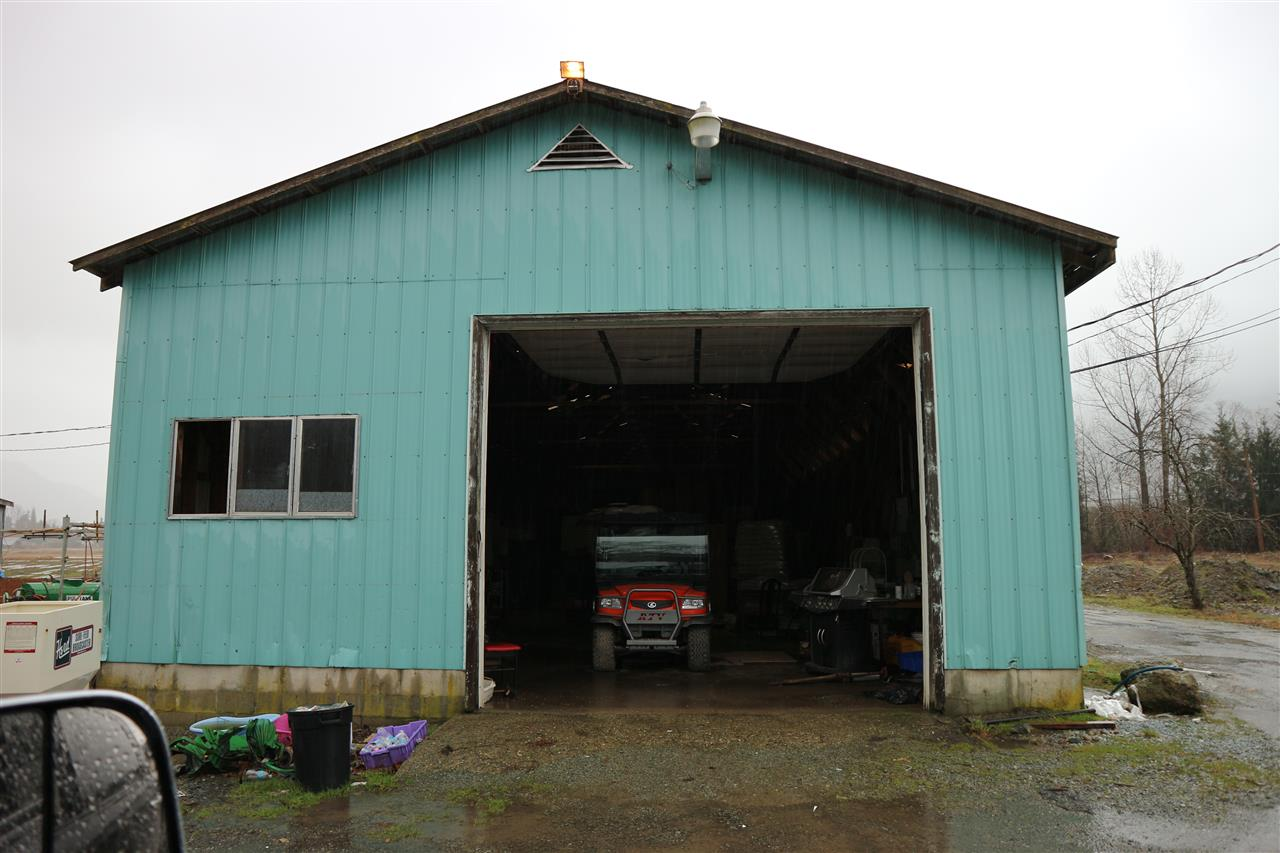 61.85 acres of flat blue berry farm with approx 35 acres blue crop and 5 acres elliot planted 2016. Connected to city water plus water license for irrigation. Currently one decent 2600Sft house plus 2nd residences is allowed to build. Many buildings including; 72' x 160' Horse barn, clear span 50' x 115' arena, 69' x 97' metal clad barn, 30' x 114' shop with 400 amp single phase power with 3 phase available from across the road, 46'x49' machine shed, 45'x100' storage shed with loading dock, 48'x100' insulated storage building, plus a 100' x 200' sand riding ring.