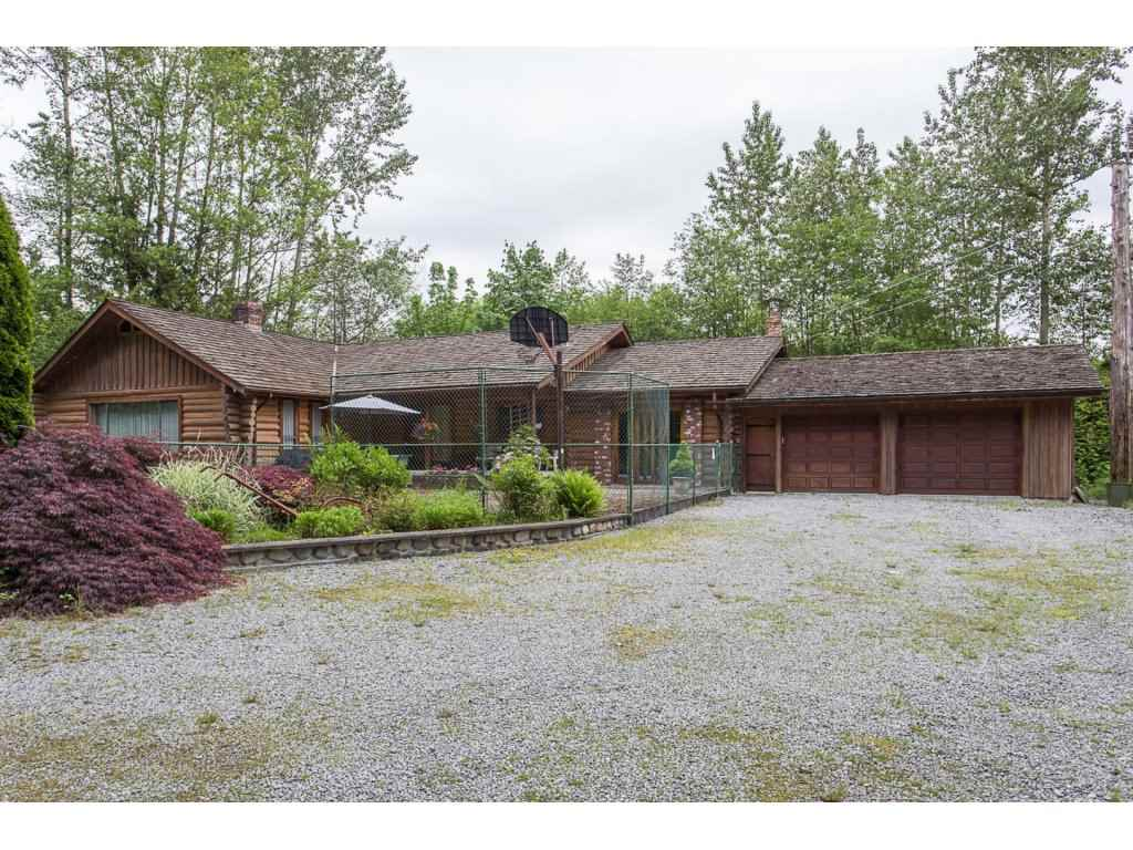 TRU LOG HOME rancher in immaculate condition - logs were refurbished recently ($14,000), new cedar shake roof 2004, hot water heat, barn 20'x32' (could be converted to a workshop), an over sized dbl garage and pool 16'x32' to enjoy on warm summer days, are just a few of the features this VERY PRIVATE 6.71 acre parcel has to offer. Located close to shopping, transportation & Meadowridge School. Original owner, this 2000 sq. ft. plus rancher has been lovingly maintained and is a perfect family home - room for kids, bikes, dogs & lots of pasture for your horses. Enjoy the privacy of country living but the convenience of an urban lifestyle - on cit water and septic. A true treasure & a rare piece of property. Appointments a must - book today!