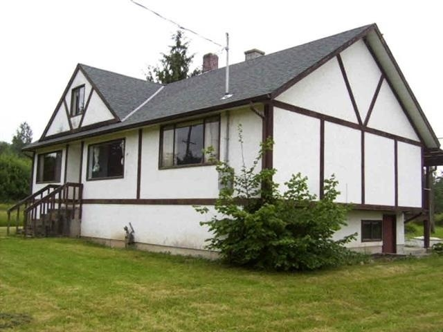A RARE & FLAT cleared 8 ACRES (264'X1320') lot under RS-3 zoning with older 1 1/2 storey basement house with two large barns (24X40)(21X31) and City Water, natural gas and septic service tank. Property features laminated flooring on main and partially finished basement bathroom. Located at fast growing AREA in Maple Ridge. Nicely maintained. So close to bus stop, elementary, and secondary schools, park and 6 minutes away to shopping and in town.