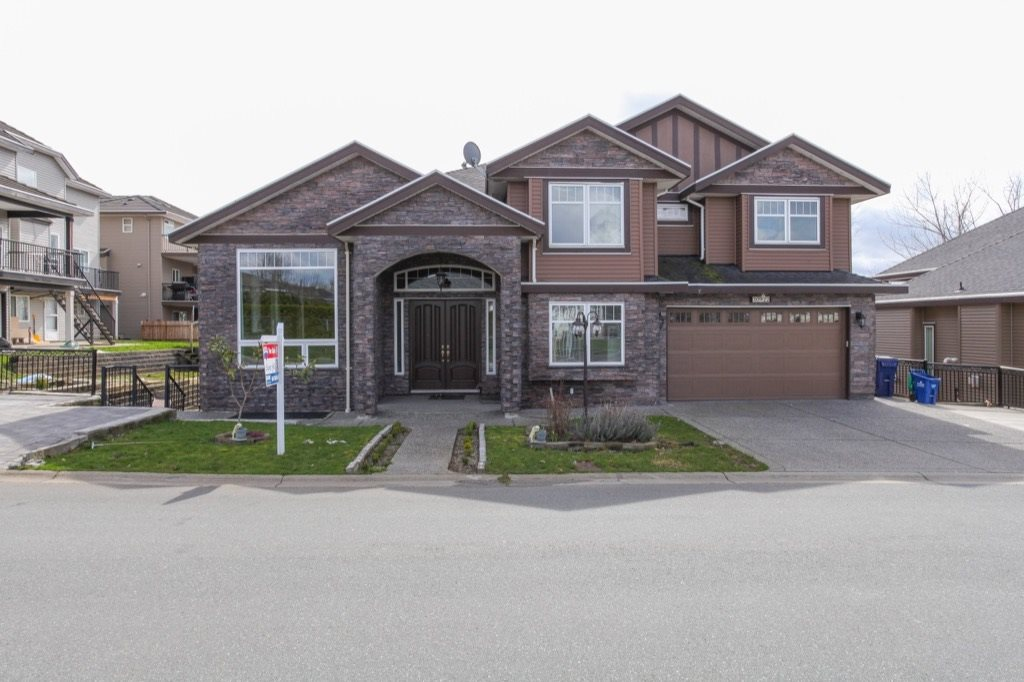 BEAUTIFUL custom-built home!!! Very OPEN floor plan with tons of extras. Family room and entry boasts high ceilings with wood cabinetry posts throughout the house. Beautiful open kitchen with a large spice kitchen. Granite all throughout the house. A large bdrmon the main floor with a full bathroom. Upstairs you will find a large Master bdrm  with a 5 piece en-suite. Another master bedroom with an en-suite and 2 large additional bedrooms. The back deck is extra large off the basement floor which is beautifully done in brick work and excellent for your family gatherings. Close to all amenities, centrally located. Its a MUST SEE!! Motivated seller, bring your offers.OPEN HOUSE Sun June 25 from 2:30-4:30pm Property contains accommodation which is not authorized (2 bdrm/1 bdrm).