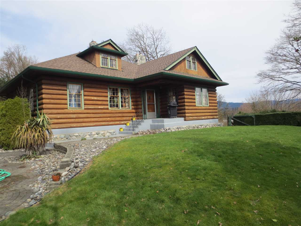 Country living only minutes from the west coast express, mission or maple ridge. Hobby farm, with space enough to raise cows, goats, chickens etc. Bring your horses! Not in the ALR, farm status potential. Live off the land. Mature landscaping with plenty of privacy. The custom crafted log home has unobstructed views of mt. Baker & the Fraser river. Have a coffee on the patio, or cozy up by the fire. Turn the bsmt into the perfect man cave or a play area for the kids. The matching 2 bay garage has a workshop. There is also a garden shed. Close to trails, camping and lakes. Enjoy nature at its best, or take a staycation. The possibilities are endless.