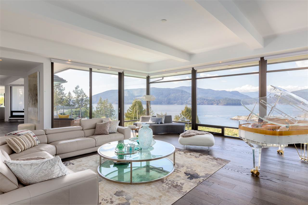 Living beside ocean, island, and mountain without busier in-town atmosphere. This West Coast Contemporary residence completely rebuilt by FX40 in 2010 and renovated in 2016 with many upgrades, 10,032 sqft living space with 5 bedrooms and 7 baths plus 3,000 sqft outdoor space, sitting on 16,553 sqft land. This home refined exquisite & peaceful lifestyle with breathtaking views on all levels, floor to ceiling windows facilitate indoor & outdoor living by connecting main and below levels to the spacious outdoor terrace space with swimming pool, covered lounge, sitting & BBQ area. Minutes from golf course, marina, ferry terminal, Whytecliff Park, and a short drive to Cypress ski resort. Truly amazing dream home.