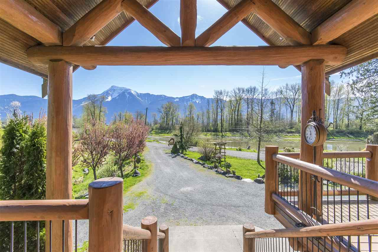 Custom built post & beam/log home on 1.23 acres located across the road from tributary of the Fraser River with water access to Fraser & Harrison. Open concept w/vaulted ceilings, exposed log beams, floor to ceiling stone f/p, chefs kitchen w/designer cabinets & large island, spacious dining room with french doors leading to huge deck overlooking water & Mt. Cheam. 5 beds, 4 full baths, loft overlooking grand living room, master bed with sitting area and your own private balcony with breathtaking views. Double garage, ample parking & lots of space for horses & other animals. Home has been used for events and film location, great potential for B&B, fishing lodge and other ventures.